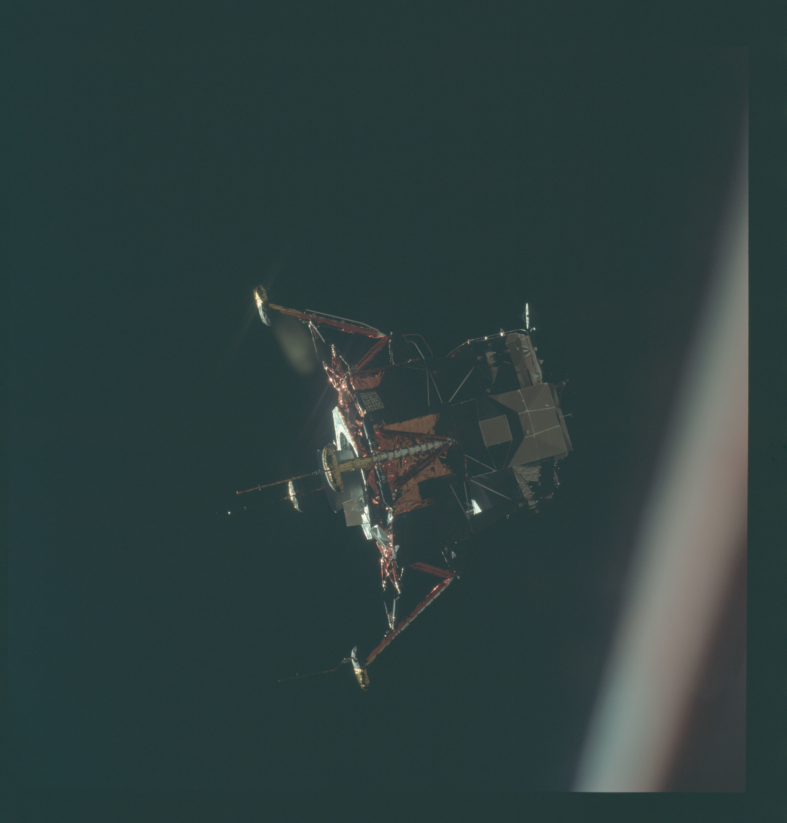 AS11-44-6580 - Apollo 11 - Apollo 11 Mission image - View of Lunar Module separation from the Command Module