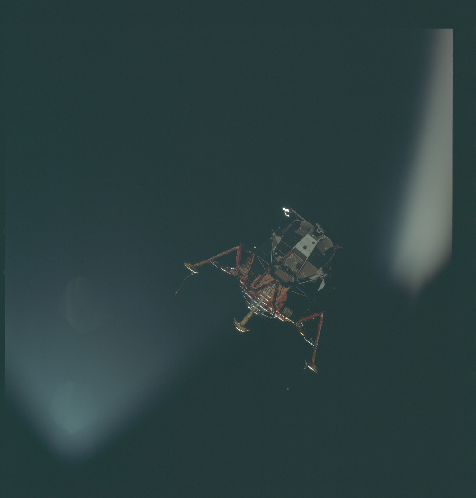 AS11-44-6586 - Apollo 11 - Apollo 11 Mission image - View of Lunar Module separation from the Command Module