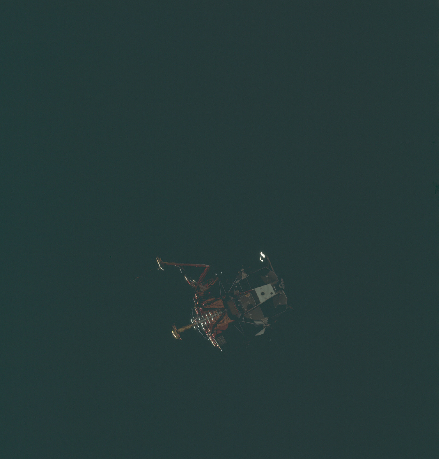 AS11-44-6587 - Apollo 11 - Apollo 11 Mission image - View of Lunar Module separation from the Command Module