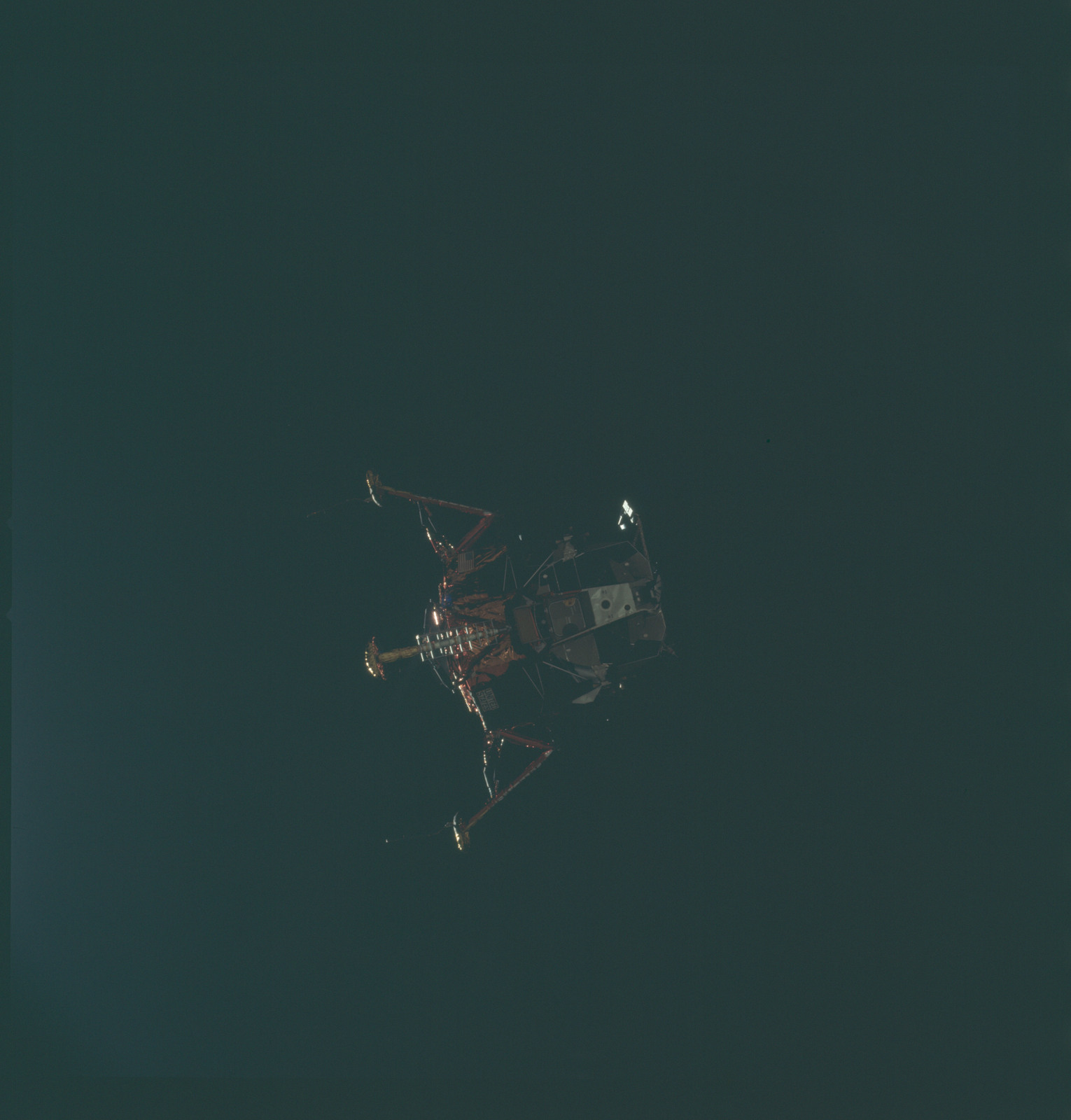 AS11-44-6589 - Apollo 11 - Apollo 11 Mission image - View of Lunar Module separation from the Command Module