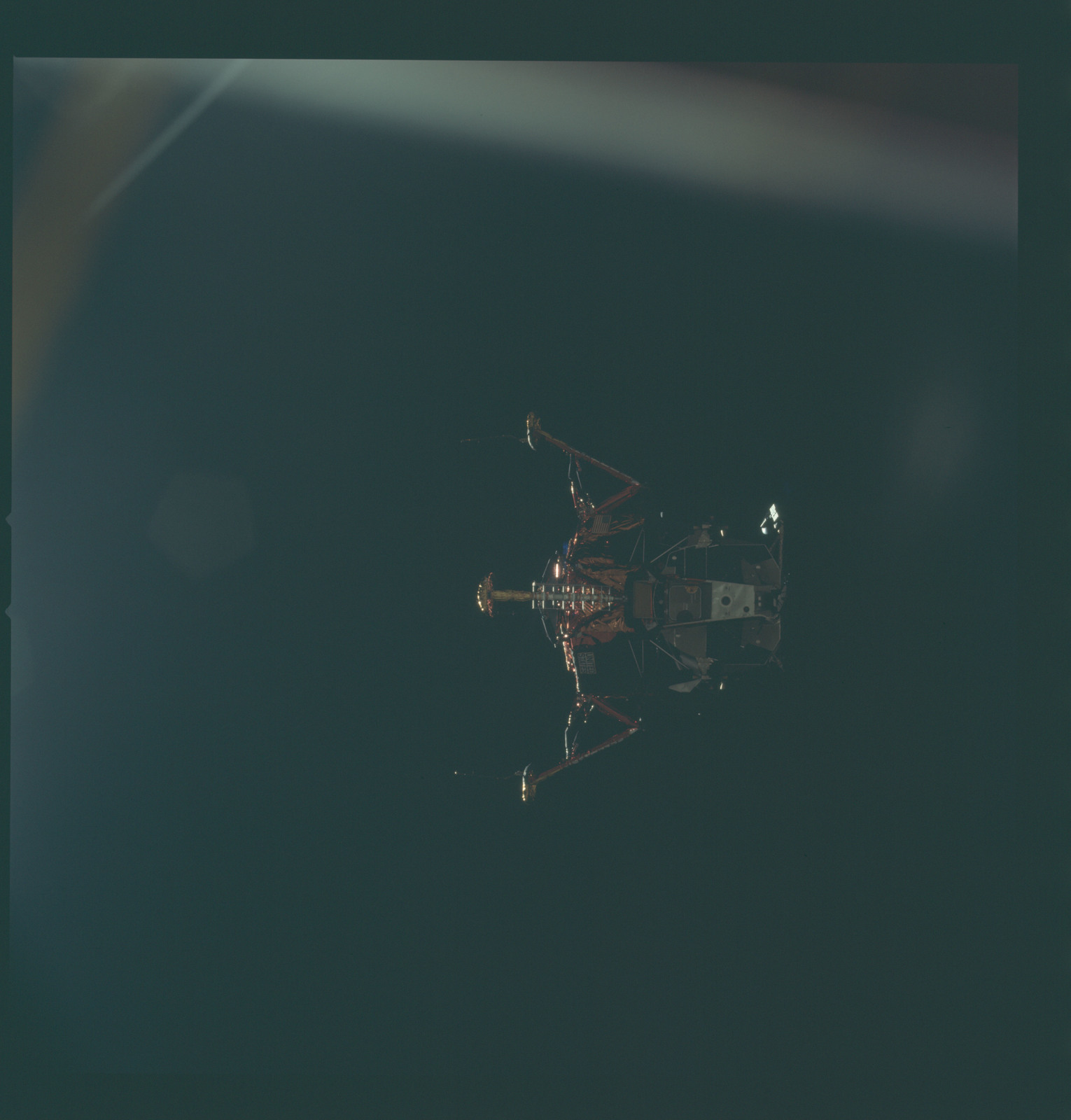 AS11-44-6590 - Apollo 11 - Apollo 11 Mission image - View of Lunar Module separation from the Command Module