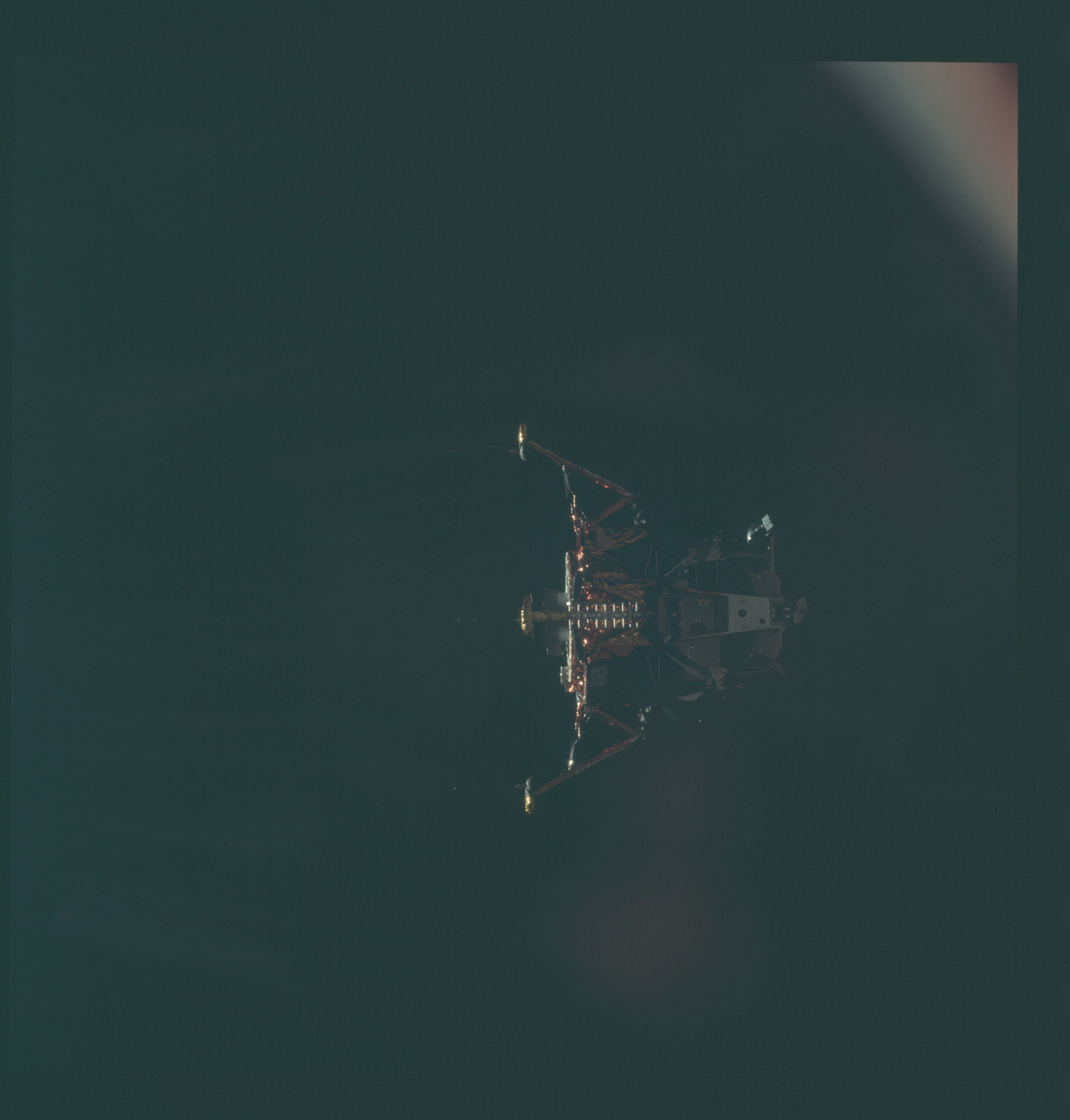 AS11-44-6591 - Apollo 11 - Apollo 11 Mission image - View of Lunar Module separation from the Command Module