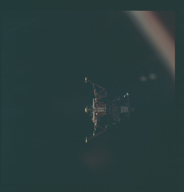 AS11-44-6592 - Apollo 11 - Apollo 11 Mission image - View of Lunar Module separation from the Command Module