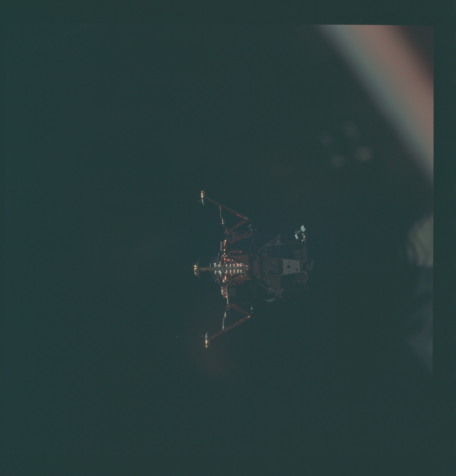 AS11-44-6593 - Apollo 11 - Apollo 11 Mission image - View of Lunar Module separation from the Command Module
