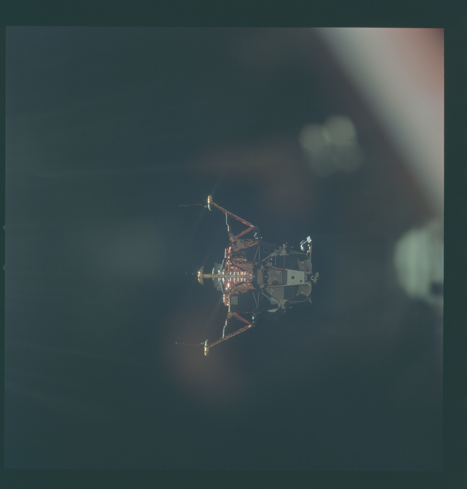 AS11-44-6597 - Apollo 11 - Apollo 11 Mission image - View of Lunar Module separation from the Command Module