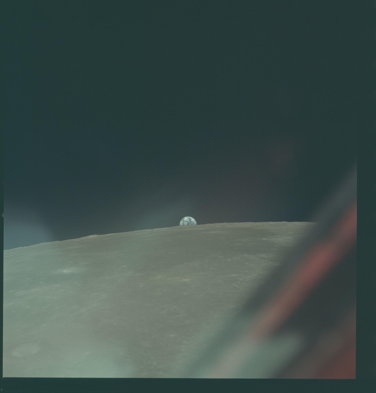 AS11-44-6602 - Apollo 11 - Apollo 11 Mission image - View of Moon limb with Earth on the horizon