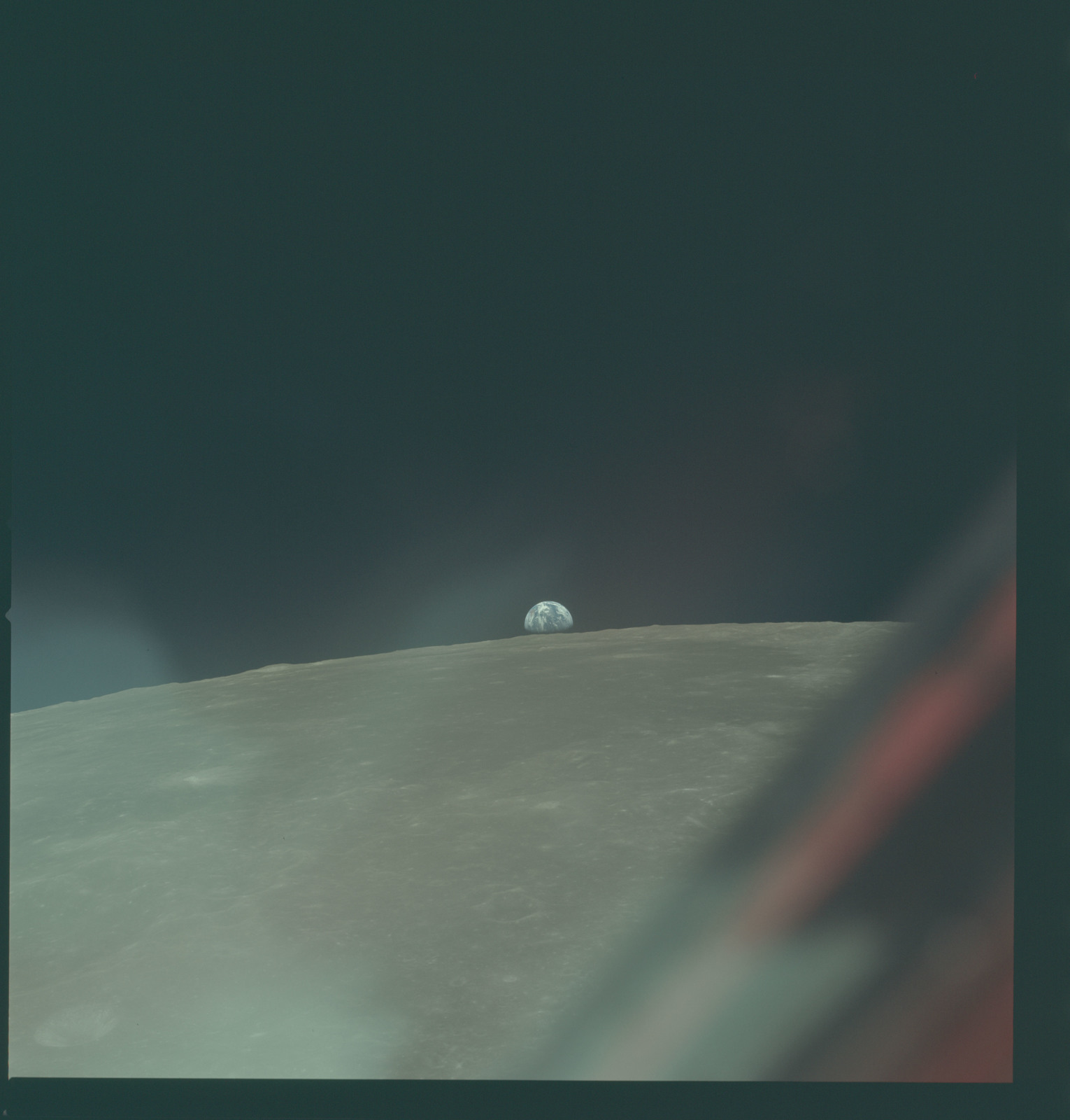 AS11-44-6603 - Apollo 11 - Apollo 11 Mission image - View of Moon limb with Earth on the horizon