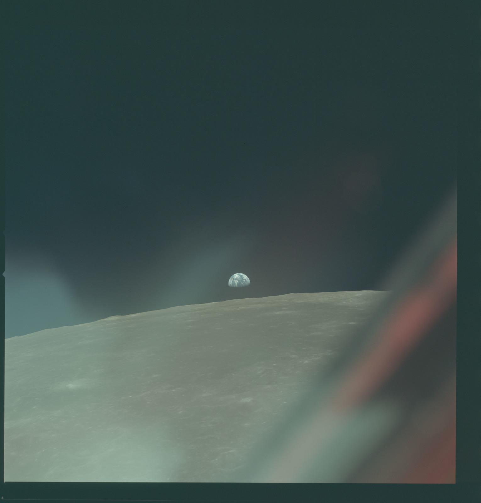 AS11-44-6604 - Apollo 11 - Apollo 11 Mission image - View of Moon limb with Earth on the horizon