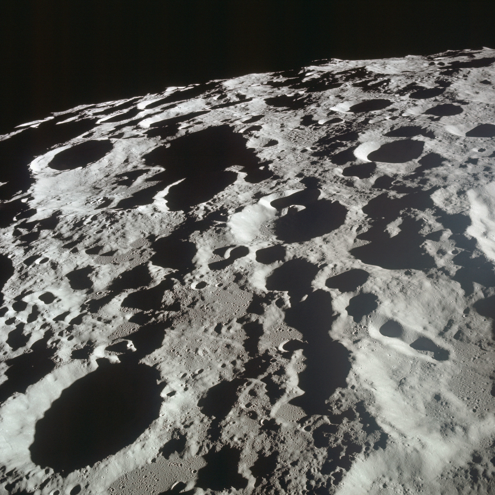 AS11-44-6610 - Apollo 11 - Apollo 11 Mission image - View of Moon limb, Crater 309 and 308