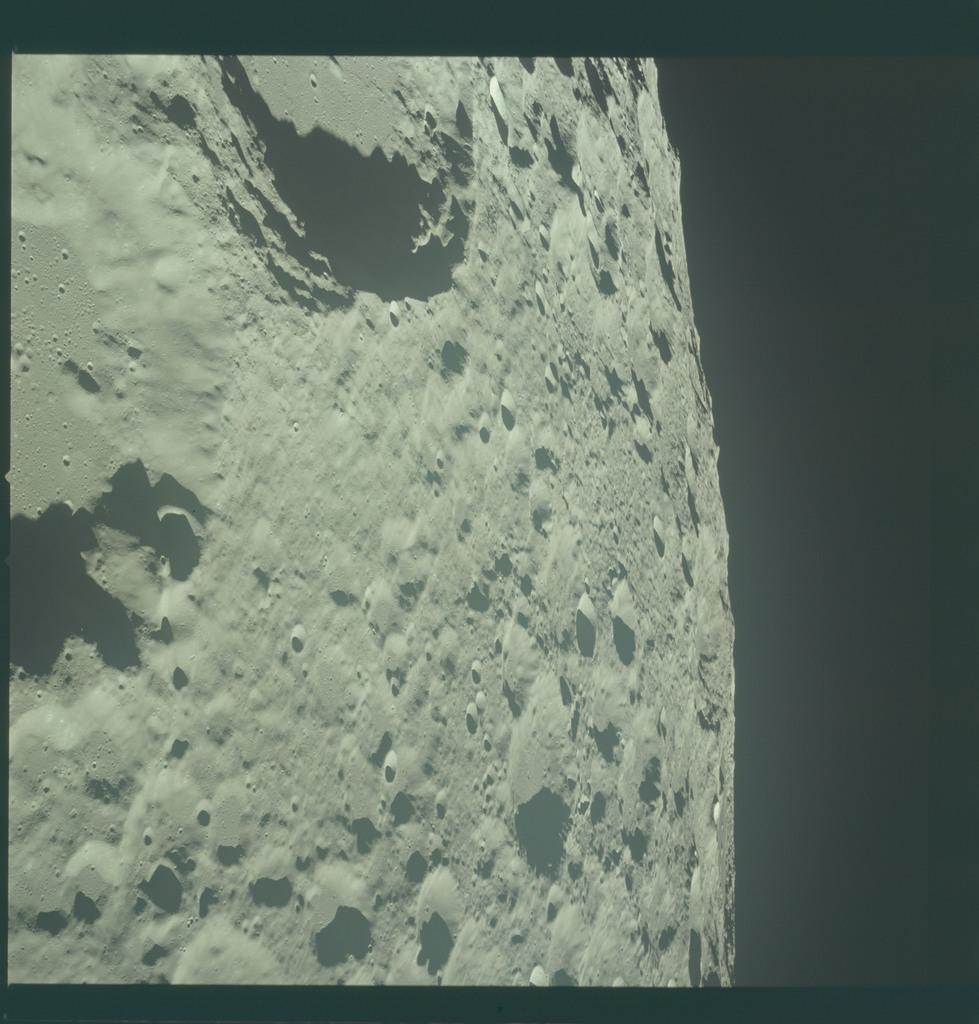 AS11-44-6613 - Apollo 11 - Apollo 11 Mission image - View of Moon limb, Crater 308