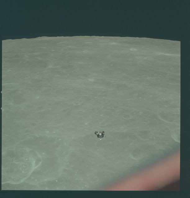 AS11-44-6623 - Apollo 11 - Apollo 11 Mission image - View of Moon limb and Lunar Module during ascent, Crater 202