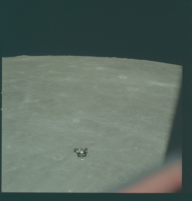 AS11-44-6625 - Apollo 11 - Apollo 11 Mission image - View of Moon limb and Lunar Module during ascent, Crater 199 and TO 55