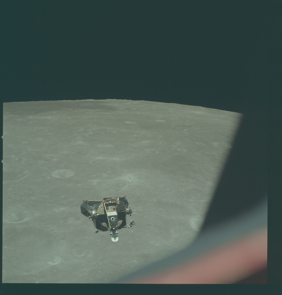 AS11-44-6630 - Apollo 11 - Apollo 11 Mission image - View of Moon limb and Lunar Module during ascent, Crater 269, Mare Smythii