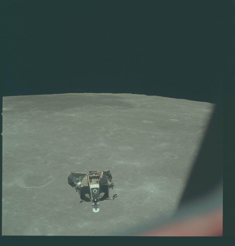 AS11-44-6631 - Apollo 11 - Apollo 11 Mission image - View of Moon limb and Lunar Module during ascent, Mare Smythii near horizon