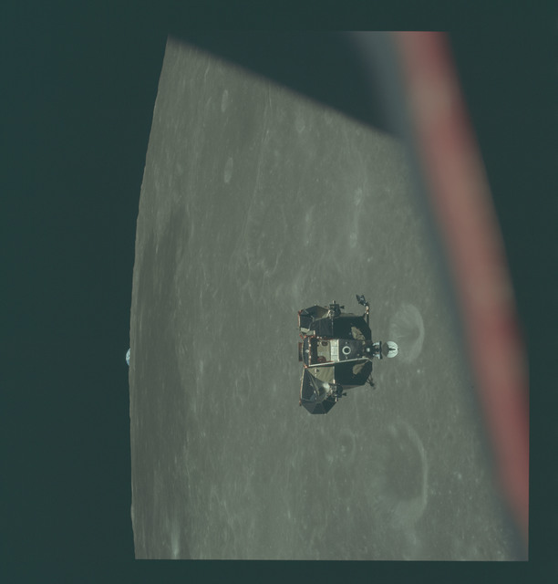 AS11-44-6632 - Apollo 11 - Apollo 11 Mission image - View of Moon limb and Lunar Module during ascent, Mare Smythii, Earth on horizon