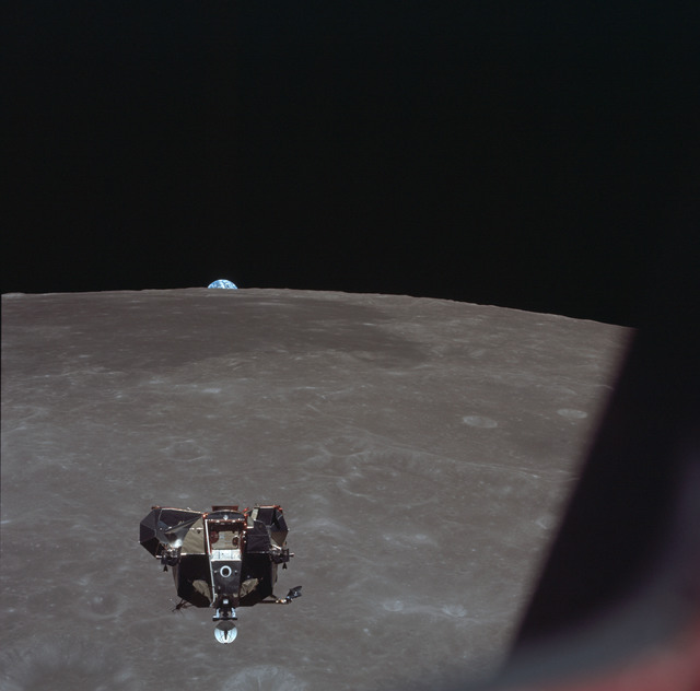 AS11-44-6633 - Apollo 11 - Apollo 11 Mission image - View of Moon limb and Lunar Module during ascent, Mare Smythii, Earth on horizon