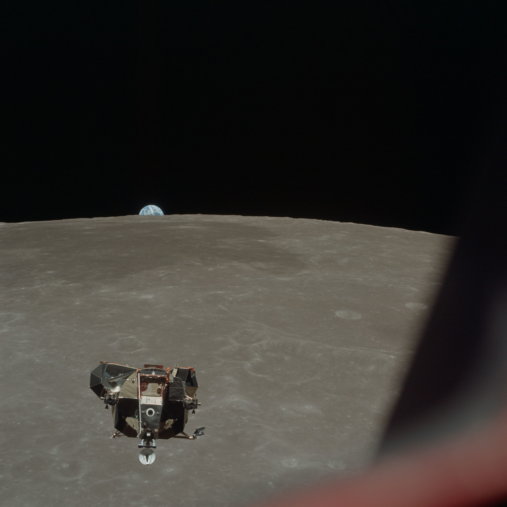 AS11-44-6634 - Apollo 11 - Apollo 11 Mission image - View of Moon limb and Lunar Module during ascent, Mare Smythii, Earth on horizon