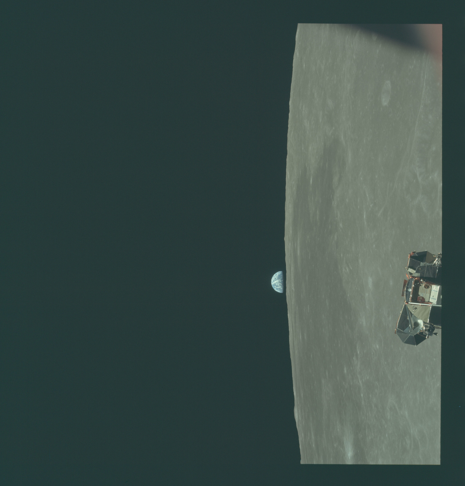 AS11-44-6635 - Apollo 11 - Apollo 11 Mission image - View of Moon limb and Lunar Module during ascent, Mare Smythii, Earth on horizon