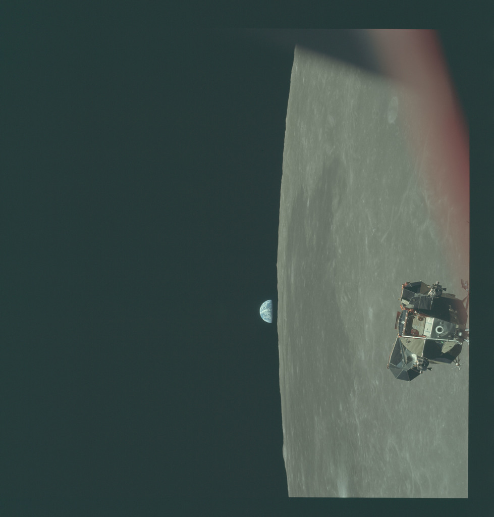 AS11-44-6636 - Apollo 11 - Apollo 11 Mission image - View of Moon limb and Lunar Module during ascent, Mare Smythii, Earth on horizon