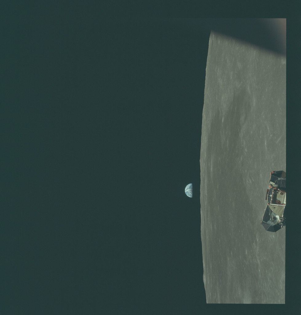 AS11-44-6638 - Apollo 11 - Apollo 11 Mission image - View of Moon limb and Lunar Module during ascent, Mare Smythii, Earth on horizon