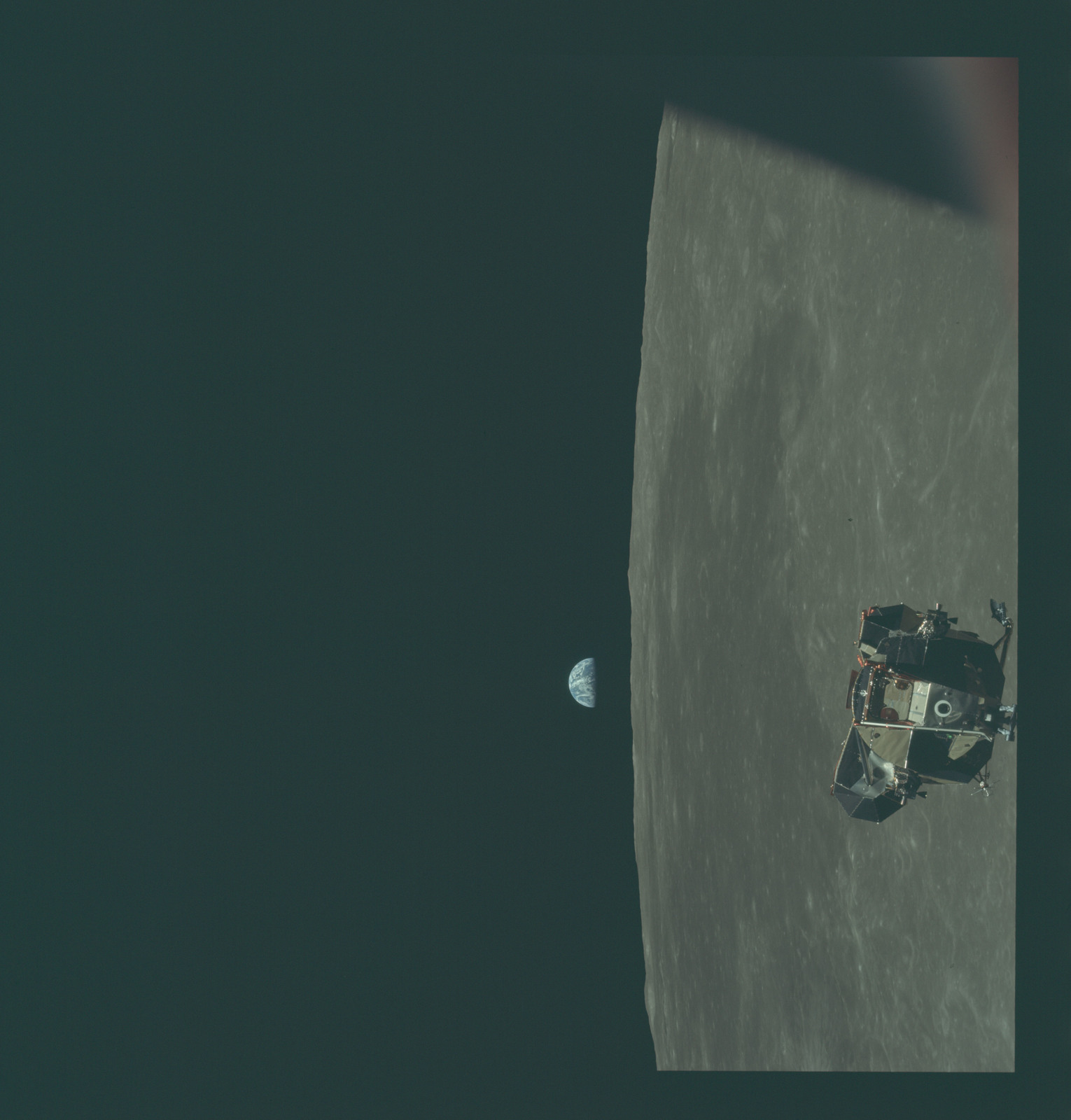 AS11-44-6639 - Apollo 11 - Apollo 11 Mission image - View of Moon limb and Lunar Module during ascent, Mare Smythii, Earth on horizon