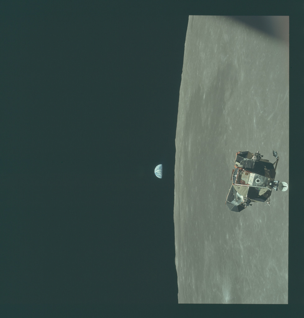 AS11-44-6640 - Apollo 11 - Apollo 11 Mission image - View of Moon limb and Lunar Module during ascent, Mare Smythii, Earth on horizon