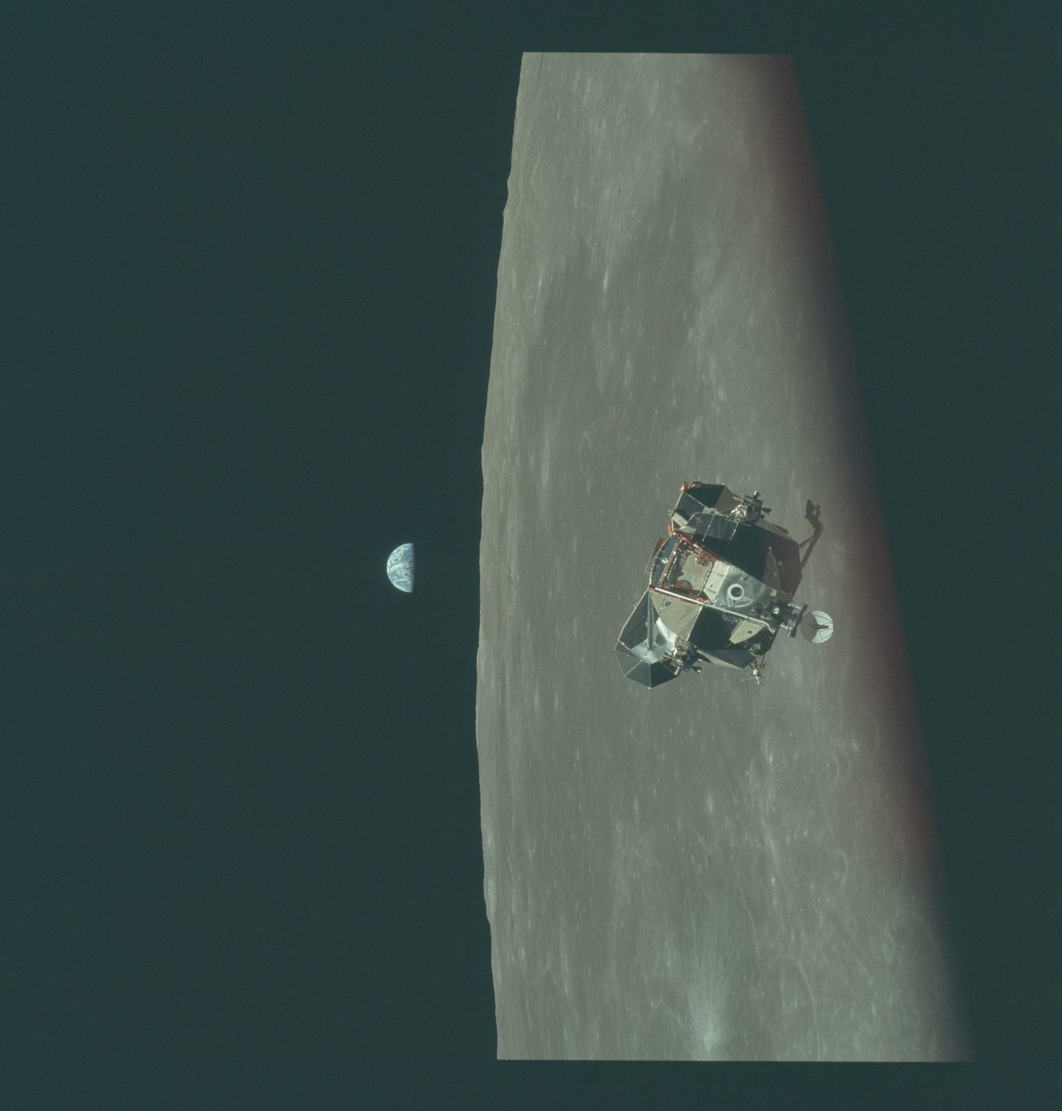 AS11-44-6641 - Apollo 11 - Apollo 11 Mission image - View of Moon limb and Lunar Module during ascent, Mare Smythii, Earth on horizon