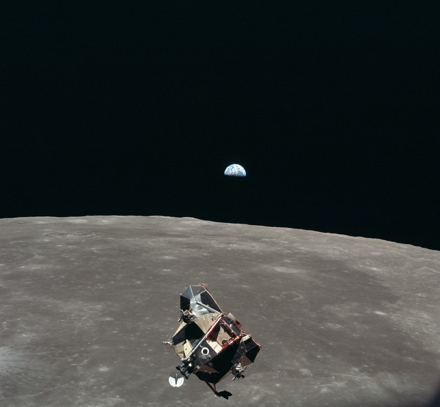 AS11-44-6643 - Apollo 11 - Apollo 11 Mission image - View of Moon limb and Lunar Module during ascent, Mare Smythii, Earth on horizon