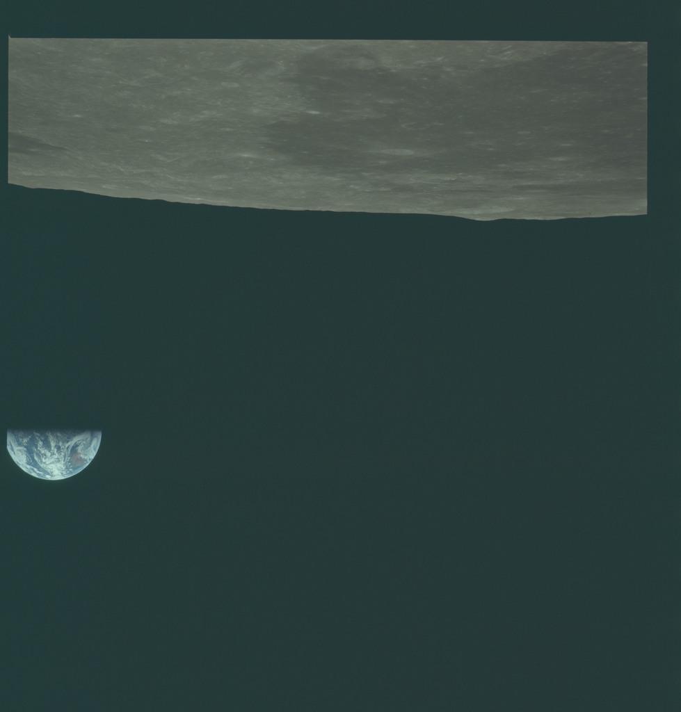 AS11-44-6648 - Apollo 11 - Apollo 11 Mission image - View of Moon limb, Mare Smythii, Earth over horizon