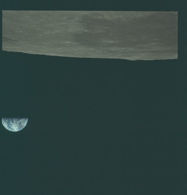 AS11-44-6648 - Apollo 11 - Apollo 11 Mission image - View of Moon limb, Mare Smythii, Earth over horizon