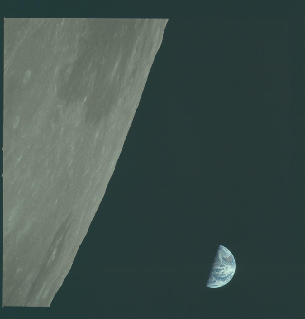 AS11-44-6649 - Apollo 11 - Apollo 11 Mission image - View of Moon limb, Mare Smythii, Earth over horizon