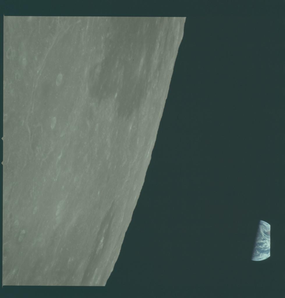 AS11-44-6650 - Apollo 11 - Apollo 11 Mission image - View of Moon limb, Mare Smythii, Earth over horizon