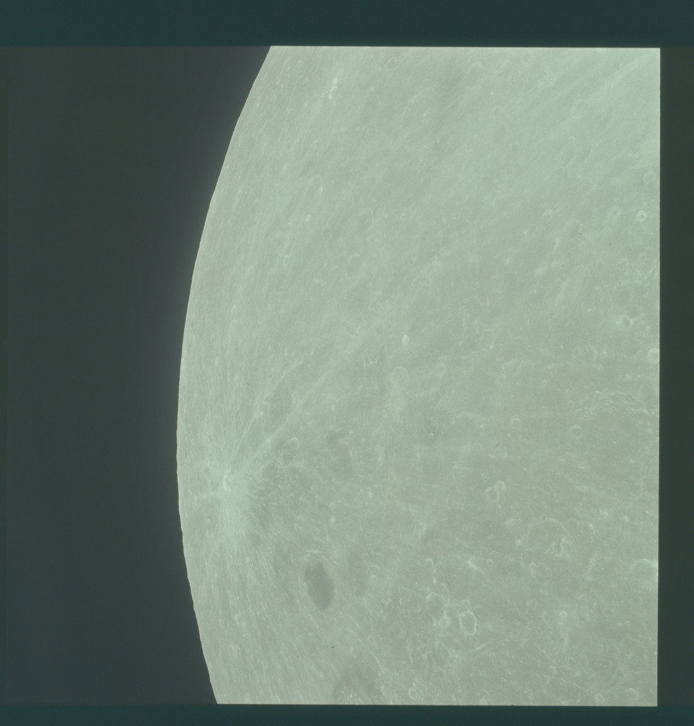 AS11-44-6660 - Apollo 11 - Apollo 11 Mission image - View of Moon limb, Joilot-Curie on left edge