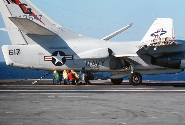 Arresting gear crewmen unhook an arresting cable from a Tactical Electronic Warfare Squadron 132 (VAQ-32) EKA-3B Skywarrior aircraft aboard the attack aircraft carrier USS AMERICA (CV 66)