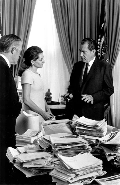 "George W. Romney and Barbara Walters Standing with President Richard Nixon at a Desk Covered with Responses to His ""Silent Majority"" Speech"
