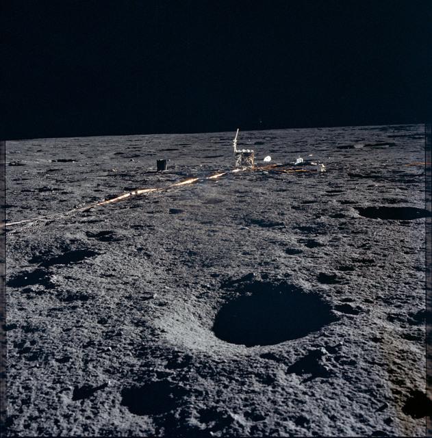 AS12-46-6821 - Apollo 12 - Apollo 12 Mission image  - Deployment of ALSEP Central Station