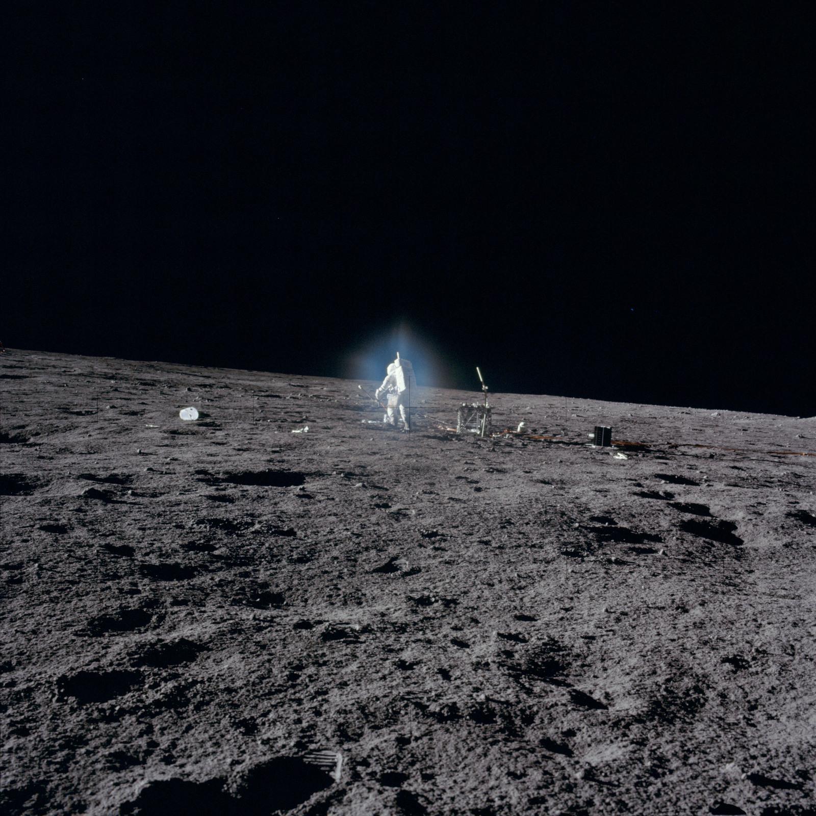 AS12-46-6826 - Apollo 12 - Apollo 12 Mission image  - Astronaut Bean deploys ALSEP Central Station