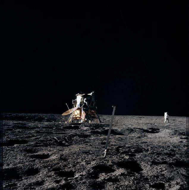 AS12-47-6899 - Apollo 12 - Apollo 12 Mission image  - LM on edge of the Surveyor Crater