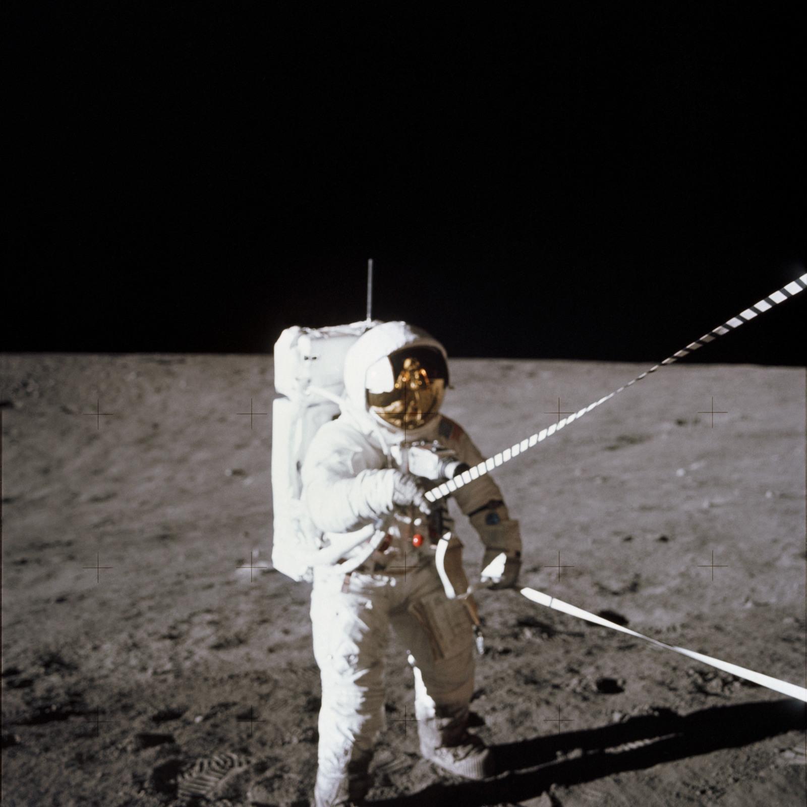 https://cdn10.picryl.com/photo/1969/11/19/as12-47-6914-apollo-12-apollo-12-mission-image-cdr-with-lunar-equipment-conveyer-1b550c-1600.jpg
