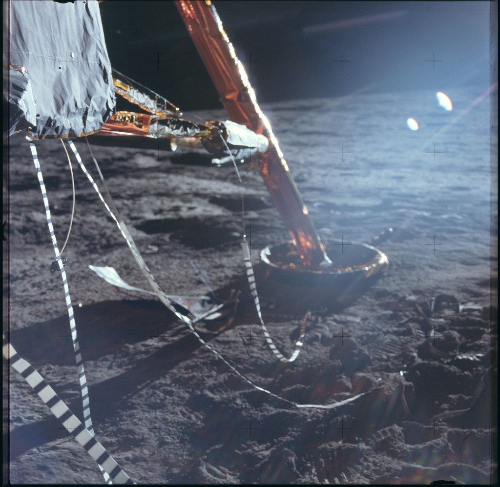 AS12-47-6915 - Apollo 12 - Apollo 12 Mission image  - View of the penetration of the -Y footpad on the lunar surface