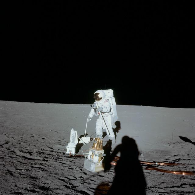 AS12-47-6919 - Apollo 12 - Apollo 12 Mission image  - Conrad with deployed ALSEP