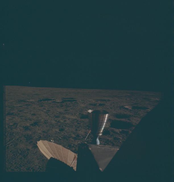 AS12-47-7016 - Apollo 12 - Apollo 12 Mission image  - LM Thruster and antenna