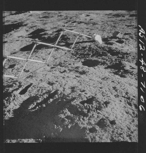 AS12-48-7106 - Apollo 12 - Apollo 12 Mission image  - Lunar surface under the Surveyor III soil mechanics surface sampler (scoop shovel)