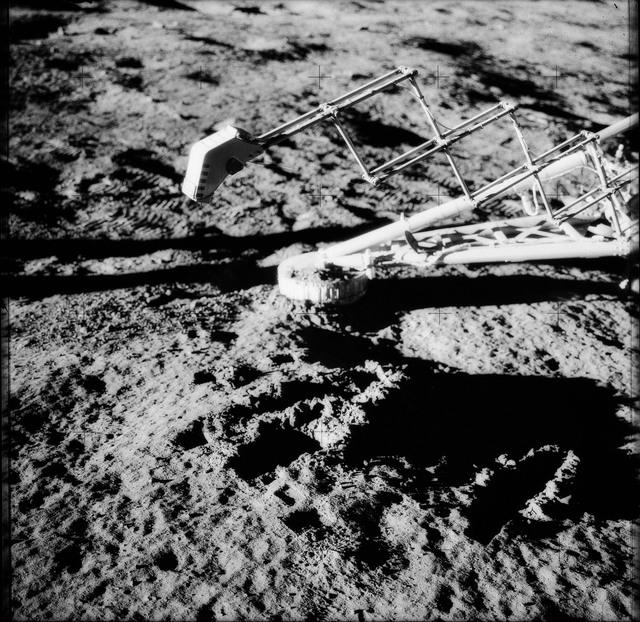 AS12-48-7128 - Apollo 12 - Apollo 12 Mission image  - Lunar surface under the Surveyor III soil mechanics surface sampler (scoop shovel)