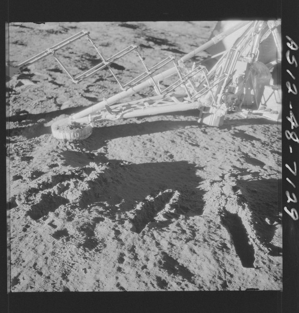 AS12-48-7129 - Apollo 12 - Apollo 12 Mission image  - Lunar surface under the Surveyor III soil mechanics surface sampler (scoop shovel)