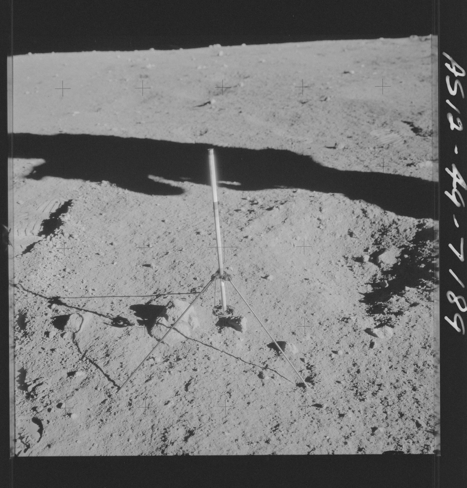 AS12-49-7189 - Apollo 12 - Apollo 12 Mission image  - View of a tri-pod holder for a core sampler on the lunar surface