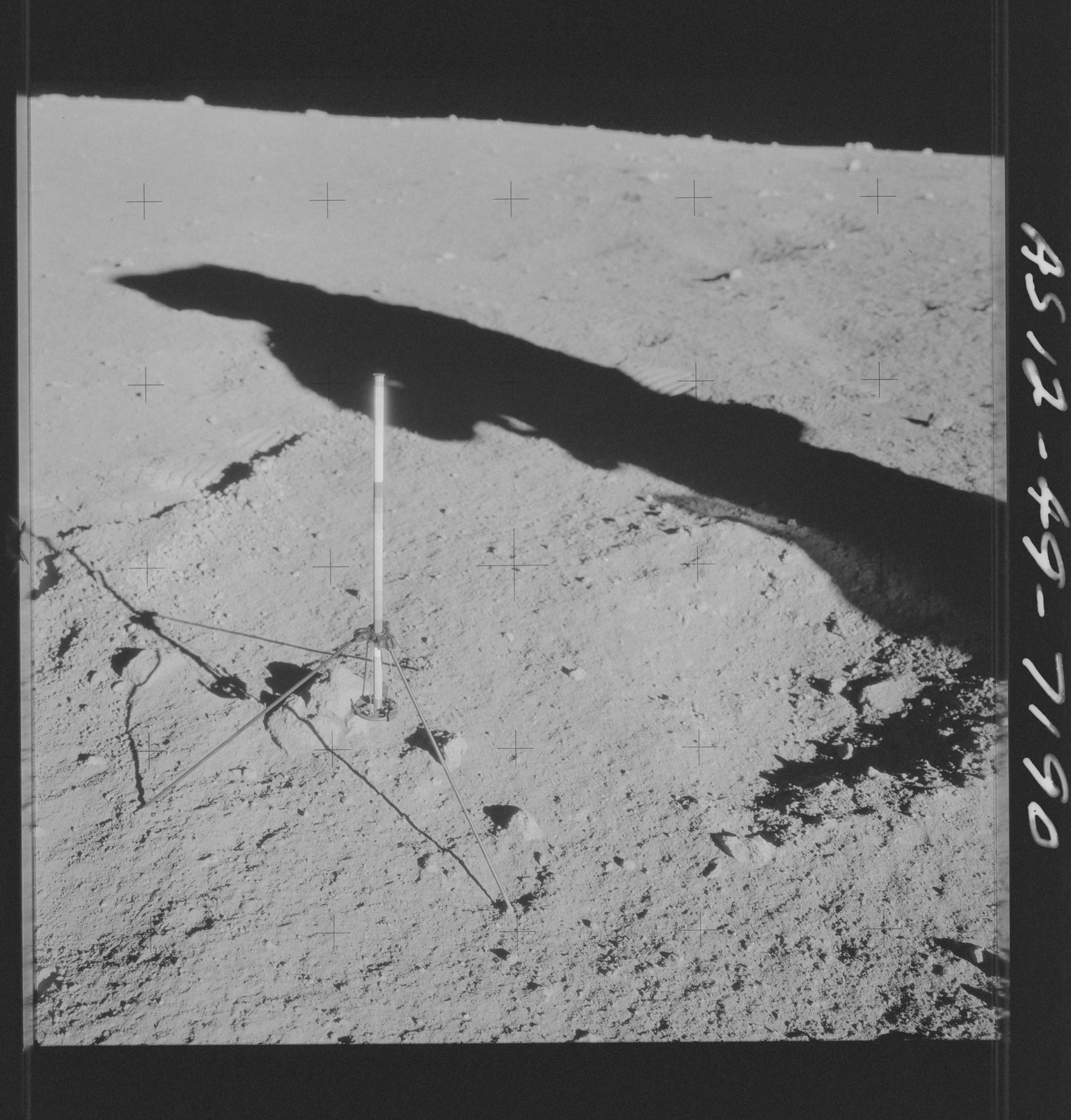 AS12-49-7190 - Apollo 12 - Apollo 12 Mission image  - View of a core sampler on the lunar surface