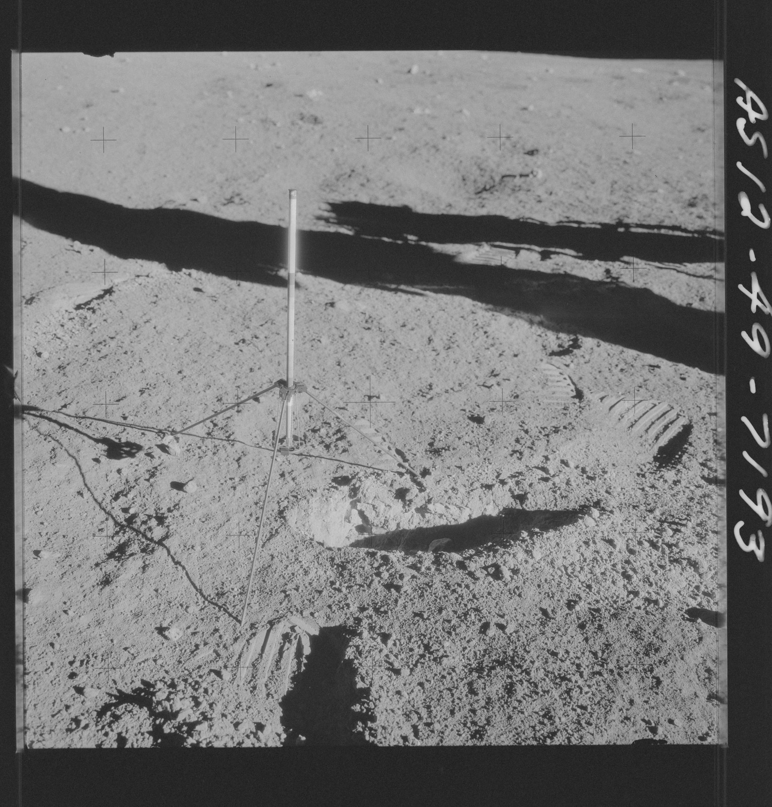 AS12-49-7193 - Apollo 12 - Apollo 12 Mission image  - View of a core sampler on the lunar surface