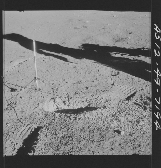 AS12-49-7194 - Apollo 12 - Apollo 12 Mission image  - View of a core sampler on the lunar surface