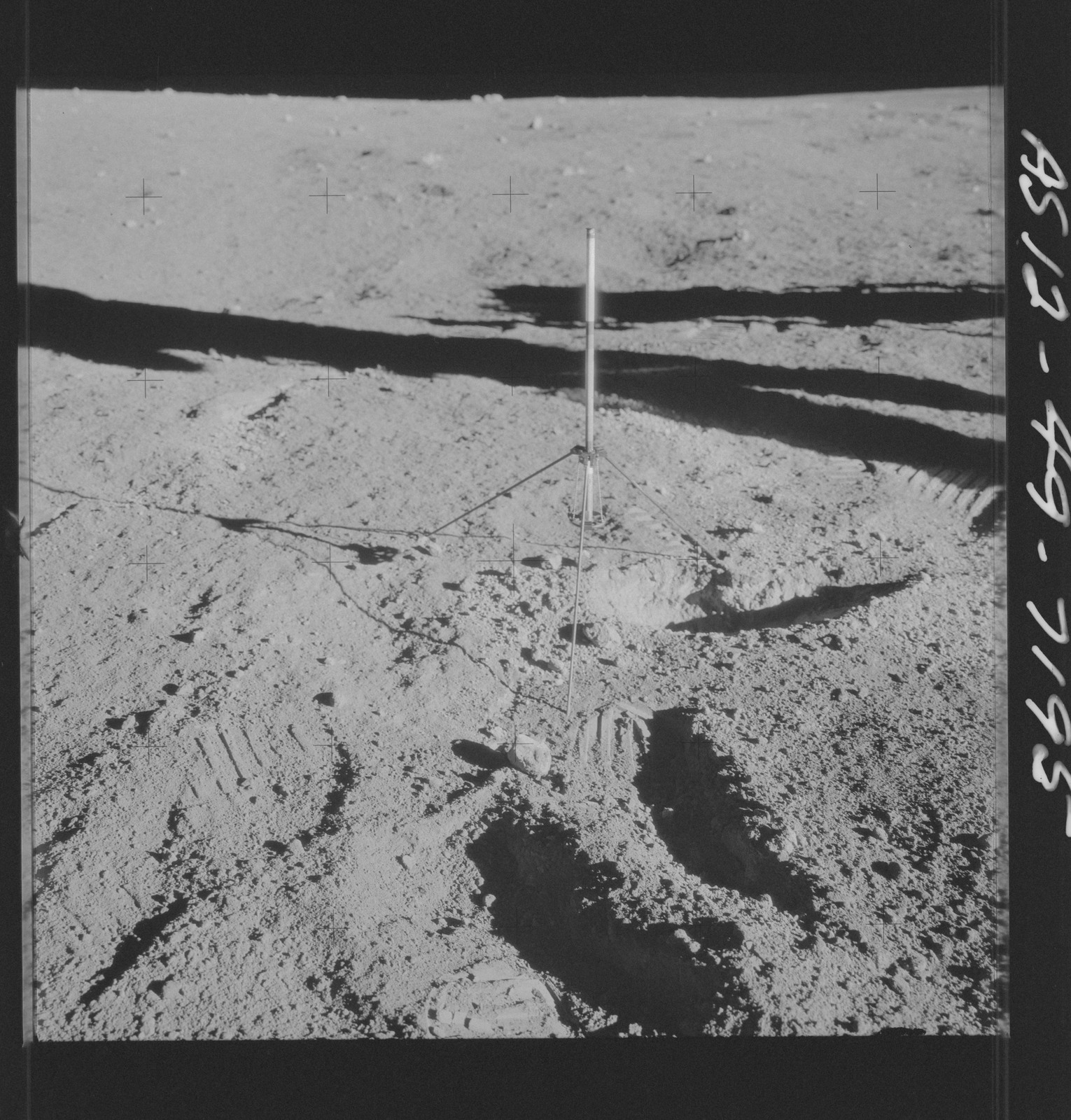AS12-49-7195 - Apollo 12 - Apollo 12 Mission image  - View of a core sampler on the lunar surface